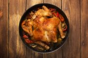 Whole baked chicken with spicy vegetables